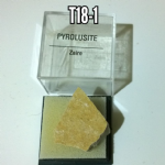 Pyrolusite specimen in display box